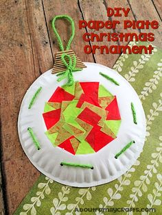 Paper Plate Christmas Ornament Decoration - Learn how to turn a paper plate into a fun Christmas ornament you can use as a decoration! (http://aboutfamilycrafts.com/paper-plate-christmas-ornament-decoration/)