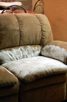 baking soda, wet down couch and sprinkle baking soda all over the seat of the couch (using a wire strainer to give some uniform coverage). Vacuum w/brush attachment. Use if one of your children gets sick on the couch.