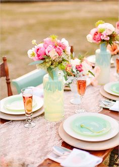 Thats pretty much my color scheme but without the darker pinks. Peach, pink, and mint wedding table decor.