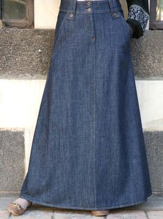 Comfortable and durable denim creates the base for this perfectly flared skirt. You'll love how easily its clean lines and flattering silhouette pair effortlessly with everything- from structured tunics or button-down shirts to flowy blouses. The simple design is embellished with modern details on the waistline, making it a truly timeless denim skirt.