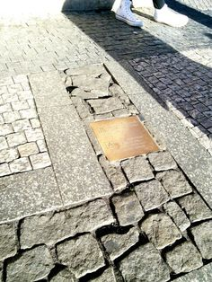 """""""A stone house from the end of the 13th century originally stood on this corner."""" [Czech/English]"""