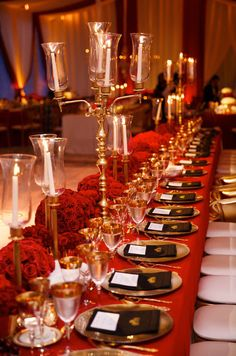 Tall candelabras and lush red floral arrangements lined the head table.