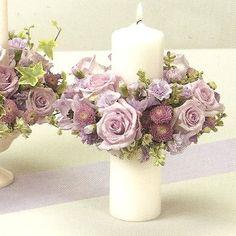 Centerpiece... around the diameter of a pillar candle. Gently lower a flower ring down ...weddingflowersandreceptionideas.com