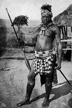 Zulu warrior armed with the iklwa stabbing spear (assegai) and iwisa club (knobkerrie). His kilt is of genet tails