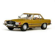 Sun Star Mercedes Benz Diecast Model Car This Mercedes Benz Hard Top Diecast Model Car is Gold and features working steering, wheels and also opening bonnet with engine, boot, doors. It is made by Sun Star and is scale (approx. Mercedes Benz Models, Miniature Cars, Steering Wheels, Diecast Model Cars, Scale Models, Engineering, Doors, Sun, Vehicles