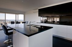 Caesarstone Classico 3100 Jet Black: http://www.caesarstone.com/en/The-Catalog/Pages/3100%20Jet%20Black.aspx