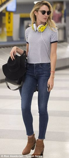 Beauties: South African model Candice turned heads in a pair of skinny blue jeans as she arrived at JFK Airport, while Karlie was out runnin...