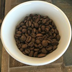 A cup of roasted beans at Theodore's Coffee in Michigan. The coffees benefit the Micah House in Honduras. www.explorelocaluniverse.com.
