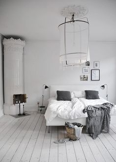 love the white and grey. It may be a little too simple and have too many modern touches, but I'm still drawn to the colors and that chandelier.