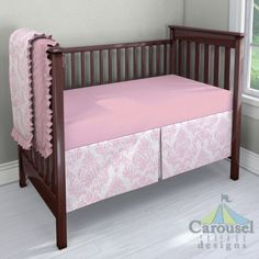 Crib bedding in Solid Bubblegum Pink, Pink Painted Damask. Created using the Nursery Designer® by Carousel Designs where you mix and match from hundreds of fabrics to create your own unique baby bedding. #carouseldesigns