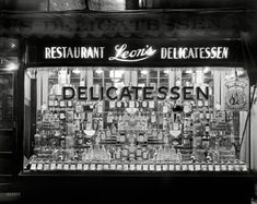 """Washington, D.C., circa 1934. """"Leon's Delicatessen, 1131 14th Street NW. Window display of whiskey."""" Courtesy of Leon Slavin (1893-1975), who, according to his obituary, """"obtained the first off-sale retail liquor license in Washington after the repeal of Prohibition."""""""