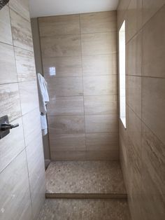 Contemporary patterns with stone create soft and inviting rooms to unwind. https://www.arizonatile.com/en/products/travertine/chapala-vein-cut #travertine #tile #shower
