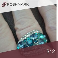 Bermuda Blue European Crystal Ring Beautiful  sparkle  and  shine, photo does not do it justice.  High quality crystal that throws off sparks even in low light!!  Platinum plated setting.  Size  9 Jewelry Rings