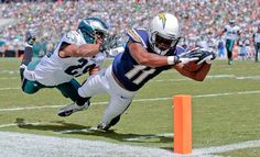 San Diego Chargers' Eddie Royal, right, dives for a touchdown as Philadelphia Eagles' Nate Allen