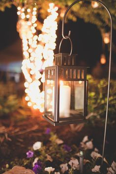 This is exactly how I was thinking people could hang their lanterns at the tables.  I think it would make it all look a lot nicer than them just setting them by their setting.  The hangers could be incorporated into the table floral arrangements.
