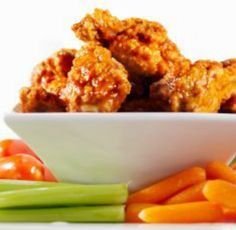 Spicy Buffalo Cauliflower 'Wings': A smart alternative to chicken wings, these veggie-based appetizers are sure to please carnivores and vegetarians alike at your Super Bowl party! | via @SparkPeople #food #healthy #recipe #football