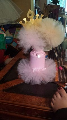 Baby girl Prego Centerpieces from my baby shower. Handmade by my mom Laurie's Creations!! Find her on facebook for the most amazing kids dresses, costumes, centerpieces, and card boxes! Everything made to order.