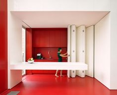 Kitchen With Folding Panel For Space-Saving Functional Solutions- Red And White Kitchen home trends design photos, home design picture at Home Design and Home Interior Contemporary Architecture, Interior Architecture, Murs Mobiles, Red And White Kitchen, Red Kitchen, Moving Walls, Space Saving Kitchen, Micro Apartment, Appartement Design