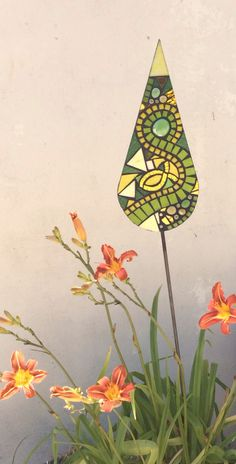 Unique handcrafted glass mosaic garden art from Primrose Mosaics, to enhance your garden and create an eye catching focal point.
