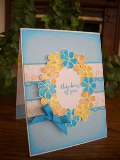 handmade card ... flower wreath ... like the color combo of blue, yellow and white ...