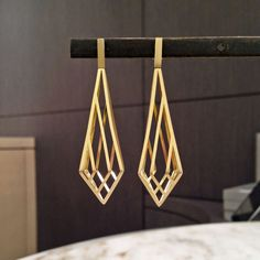 Three Dimensional Gold Prism Cage Earrings | From a unique collection of vintage dangle earrings at https://www.1stdibs.com/jewelry/earrings/dangle-earrings/