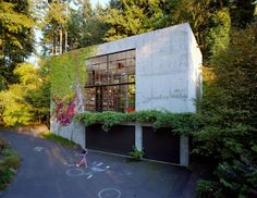 """Olson Kundig Artchitects """"The Brain"""" - Benjamin likes the simplicity, glass, light, floor to ceiling bookcases and functional use of non-window space"""