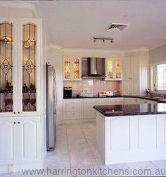 Classic Kitchens Gallery | Harrington Kitchens - continuation of kitchen cabinets around corner could be useful.
