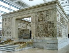 The Ara Pacis  is an altar in Rome dedicated to Peace, the Roman goddess. The monument was commissioned by the Roman Senate on 4 July 13 B.C. to honour the return of Augustus to Rome after his three years in Hispania and Gaul and consecrated on 30 January 9 BC by the Senate in celebration of the peace brought to the Roman Empire by Augustus' military victories.