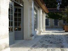 orangerie montmoreau. doors + stone. gorgeous!!