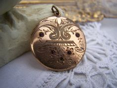 Hey, I found this really awesome Etsy listing at https://www.etsy.com/listing/123544506/antique-locket-gold-engraved-vintage