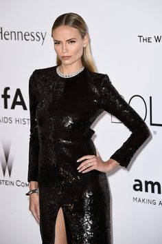 Half Up Half Down Lookbook: Natasha Poly wearing Half Up Half Down (2 of 12). Natasha Poly contrasted her vampy gown with a sweet, beribboned half-up hairstyle when she attended the amfAR Cinema Against AIDS Gala.