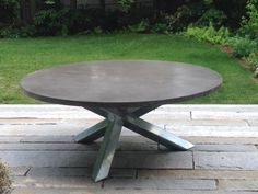 &2' diameter concrete table made by naan industries