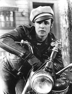 The Wild One (1953) Rebellious for it's time, Marlon Brando created cool, wearing a black motorcycle jacket with cuffed jeans and a leather cap. For years the look stood for rebellion, rock 'n' roll and hard living. Now the look says fashion cool.