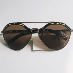 Brow Bar Sunnies Super stylish brow bar sunglasses with metal frames and tortoise accents. Lens are light tint and has a cool shape! It's missing one of the nose support on the right side (seen in 3rd photo) cause of it unknown, it arrived to me in that condition but can easily be replaced. Must have for this season! [Only one left in stock] Accessories Sunglasses