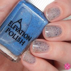 SBP: Moving on a scene surreal  Description: Sheer, near clear (topper) Thermal shift to blue with ultra chrome flake shimmer, charcoal flake shimmer and sparse holographic pigment  TIPS: I like to wear it on its own as a base then put nail vinyls or stamp over it to give a negative space mani look that thermals. I also like to wear this one as a topper over blues and greys