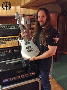John and his brand new Musicman JP13 7 strings! Cool!