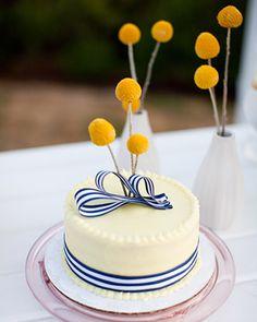 Striped ribbon decorates the small cutting cake