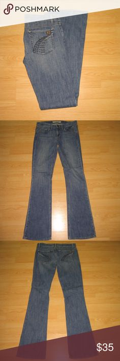 """Joe's Jeans Rocker in Slash These jeans are preloved but still in very good condition. They are the Rocker Lean Flare Fit jean in Slash wash. The flare is not a real big flare, but just a little bit more than a normal bootcut. Features Tri-colored embroidery thread and studs on back pockets. Made of 98% cotton 2% lycra. Tag size is 28.  Waist across with natural dip is 16"""" Waist across when aligned is 16.5"""" Front Rise is 8"""" Inseam is 35"""" Joe's Jeans Jeans Flare & Wide Leg"""