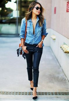 Julie Sariñana of Sincerely Jules wears a denim shirt, skinny leather pants, a shoulder bag, and pumps