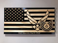 american flag art Handcrafted Wooden American Flag with Air Force Emblem and Rank Insignia. This flag is carved and cut by CNC for precision, hand painted, then protected with poly co Wooden American Flag, American Flag Wood, Luftwaffe, Air Force Tattoo, Air Force Symbol, Air Force Gifts, Military Shadow Box, Ranger, Wood Flag