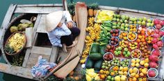 They're taking farmers' markets to a whole other level at the Cai Be floating market.