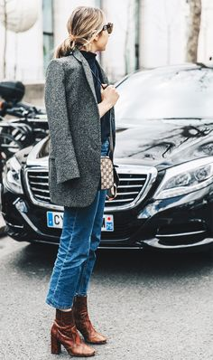 1. Focus on your outer layer. Throw on an overcoat with clean, minimal lines to sharpen your look.