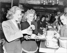 Marlene Dietrich and Rita Hayworth serving coffee to servicemen at the Hollywood Canteen, 1944