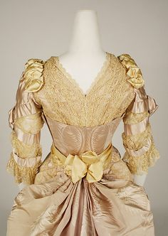 Dress, Evening, back bodice detail.  House of Worth (French, 1858–1956).  Designer: Jean-Philippe Worth (French, 1856–1926).  Date: 1887–89.  Culture: French.  Medium: silk.  Dimensions: Length at CB (a): 9 1/4 in. (23.5 cm). Length at CB (b): 60 in. (152.4 cm).  Credit Line: Gift of Orme Wilson and R. Thornton Wilson, in memory of their mother, Mrs. Caroline Schermerhorn Astor Wilson, 1949. Accession Number:49.3.24a–e.