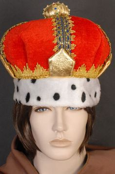A very regal red crown with blue and gold brocade trim and the base of the crown trimmed with 'ermine'