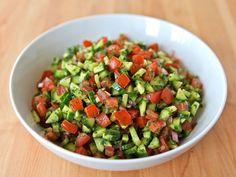This salad recipe from Israel is versatile and tasty. Persian cucumbers, tomatoes, parsley, olive oil, lemon juice, onion. Vegan, kosher, pareve