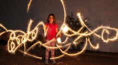 Sparkler Photography- hello everyone, it's photographer Jennifer Valencia here with a tutorial on how to photograph trailing light from holiday sparklers and still have a person's face show up clearly.