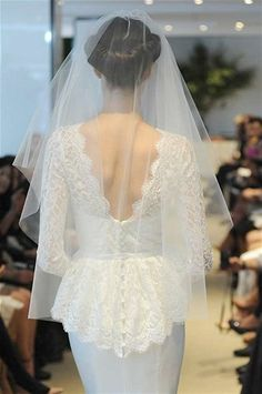 ..The beautifully simple style of the veil, which is a perfect length, shows off the beautiful detail of this dress.