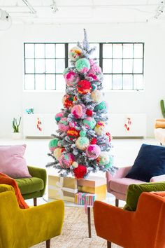 Our new studio seating area with @article, jumbo pom pom ornaments, and how we decorated the studio for Christmas all in one big hoorah! #ChristmasDecor #christmas #homedecor #homedecorideas