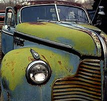 Art is everywhere, even in a rusted old car.